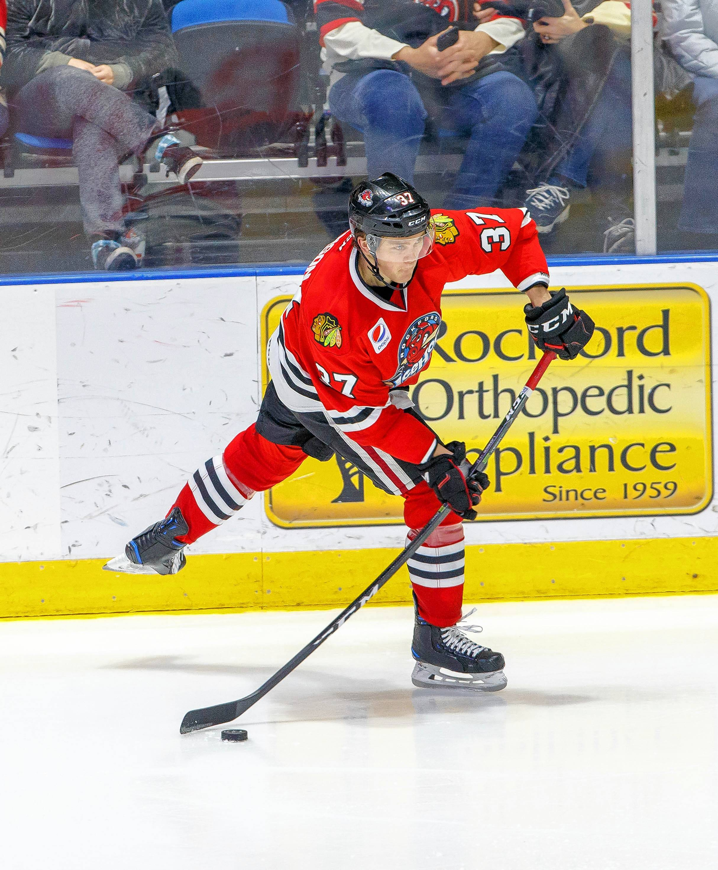 Luke Johnson, who won a national title at North Dakota, is one win away from helping the Chicago IceHogs advance to the Western Conference finals of the Calder Cup playofs.