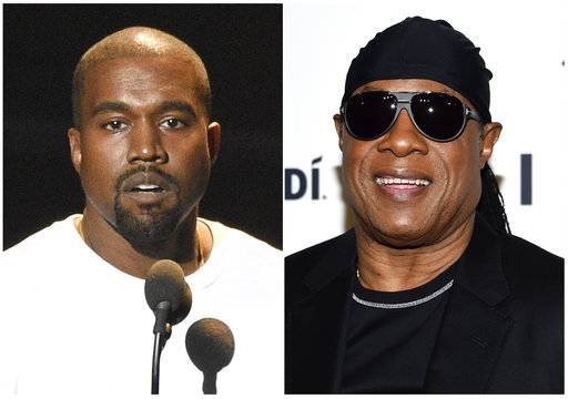 "In this combination photo Kanye West speaks at the MTV Video Music Awards in New York on Aug. 28, 2016, left, and Stevie Wonder attends the TIDAL X: Brooklyn 3rd Annual Benefit Concert in New York on Oct. 17, 2017.  Wonder has called out West for saying slavery is a ""choice,� calling the idea ""foolishness� likening it to Holocaust denial. Wonder brought up West without prompting during an interview Thursday, May 10, 2018, after a show at a West Hollywood club."