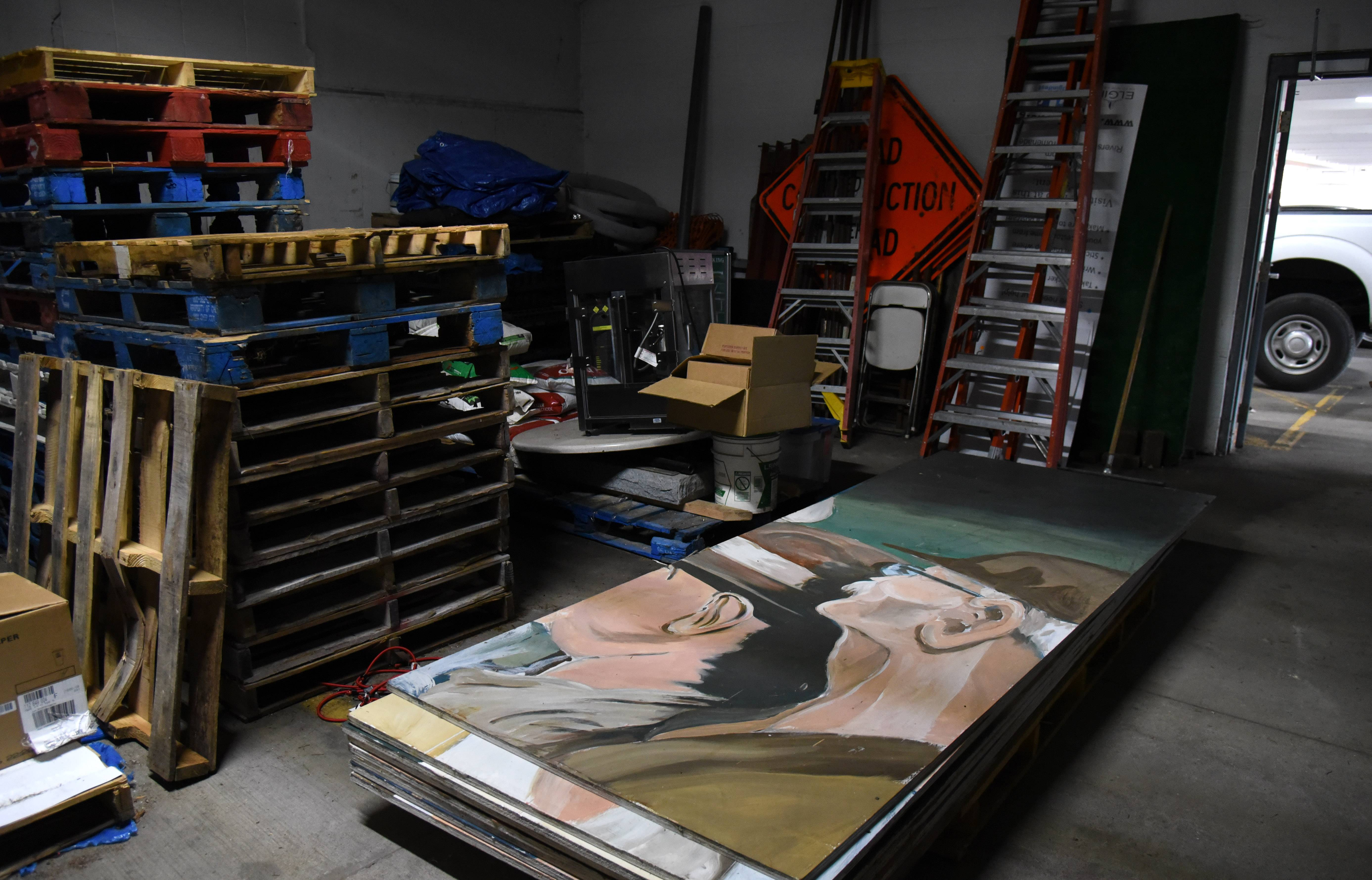 "The ""American Nocturne"" mural that stirred controversy in Elgin is housed in a storage closet in a downtown parking deck. Artist David Powers wants it back."