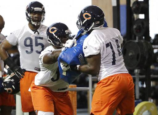 Chicago Bears defensive line Bilal Nichols (98) works with defensive line Bunmi Rotimi (74) during the NFL football team's rookie minicamp Friday, May 11, 2018, in Lake Forest, Ill.