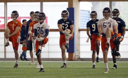 Chicago Bears players stretch during the NFL football team's rookie minicamp Friday, May 11, 2018, in Lake Forest, Ill.