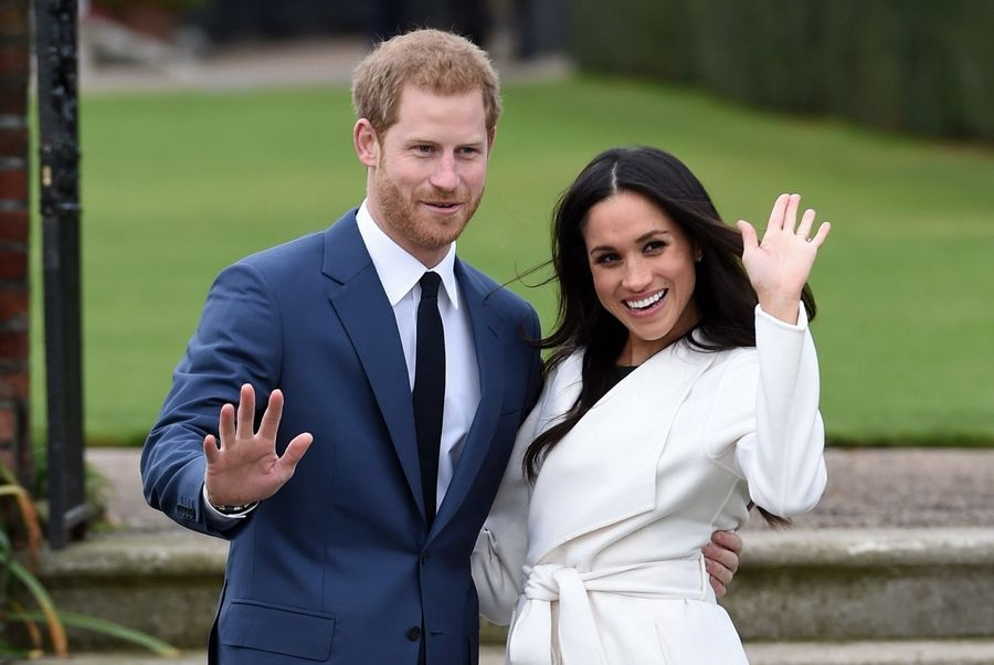 Britain's Prince Harry and Meghan Markle pose for the media in the grounds of Kensington Palace in London, after announcing their engagement. The couple will wed on May 19.