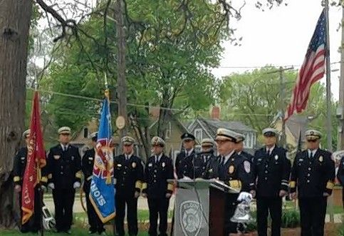 Carpentersville Fire Chief John Paul Schilling speaks about the importance of recognizing the mental as well as physical stresses firefighters endure during the Elgin Area Firefighters' Memorial Service observed by 16 departments Saturday in front of the Elgin Fire Barn No. 5 Museum.