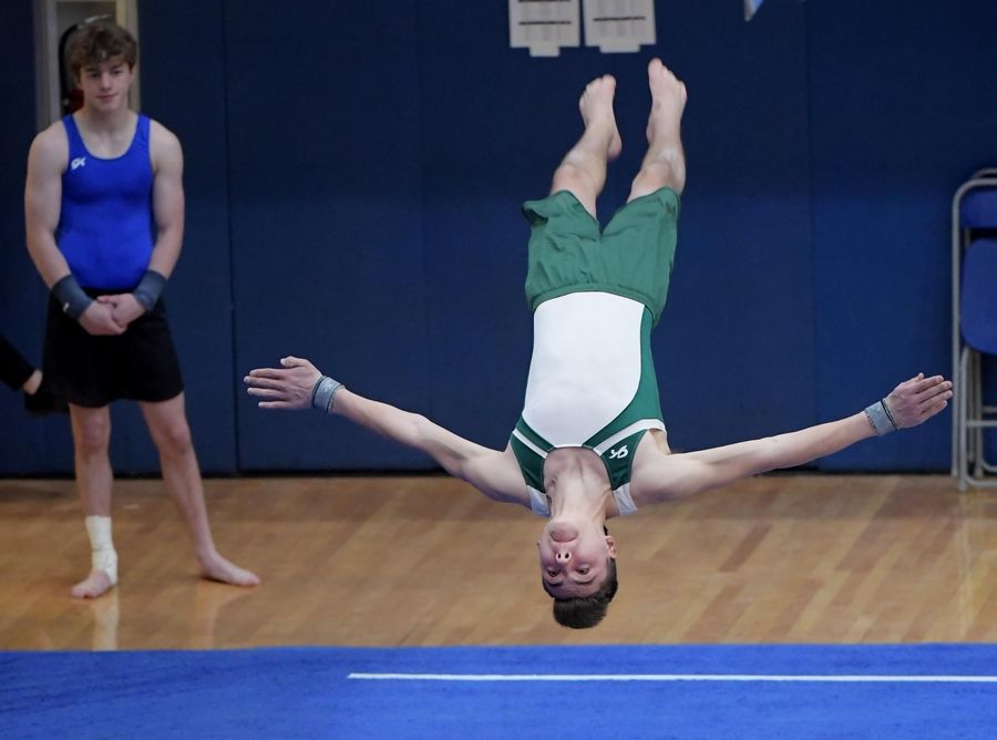 Glenbard West's Alexander Demeris performs on the floor exercise at the boys gymnastics state finals at Hoffman Estate High School Saturday night.
