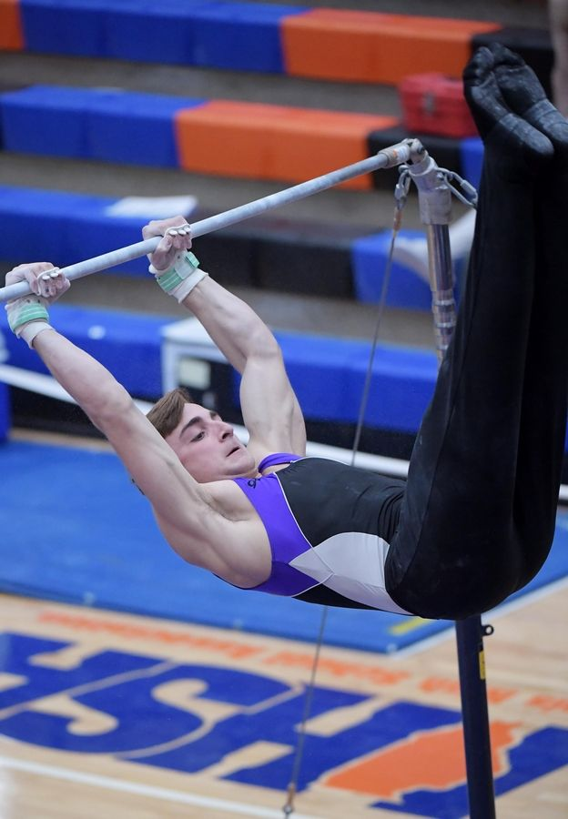 Downers Grove North's Lukas Elisha performs on the high bar at the boys gymnastics state finals at Hoffman Estate High School Saturday night.
