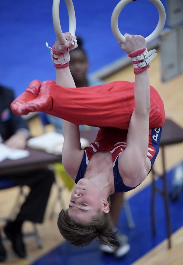 Neuqua Valley's Michael Baren performs on the still rings at the boys gymnastics state finals at Hoffman Estate High School Saturday night.