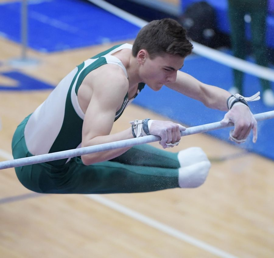 Glenbard West's Alexander Demeris performs on the high bar at the boys gymnastics state finals at Hoffman Estate High School Saturday night.