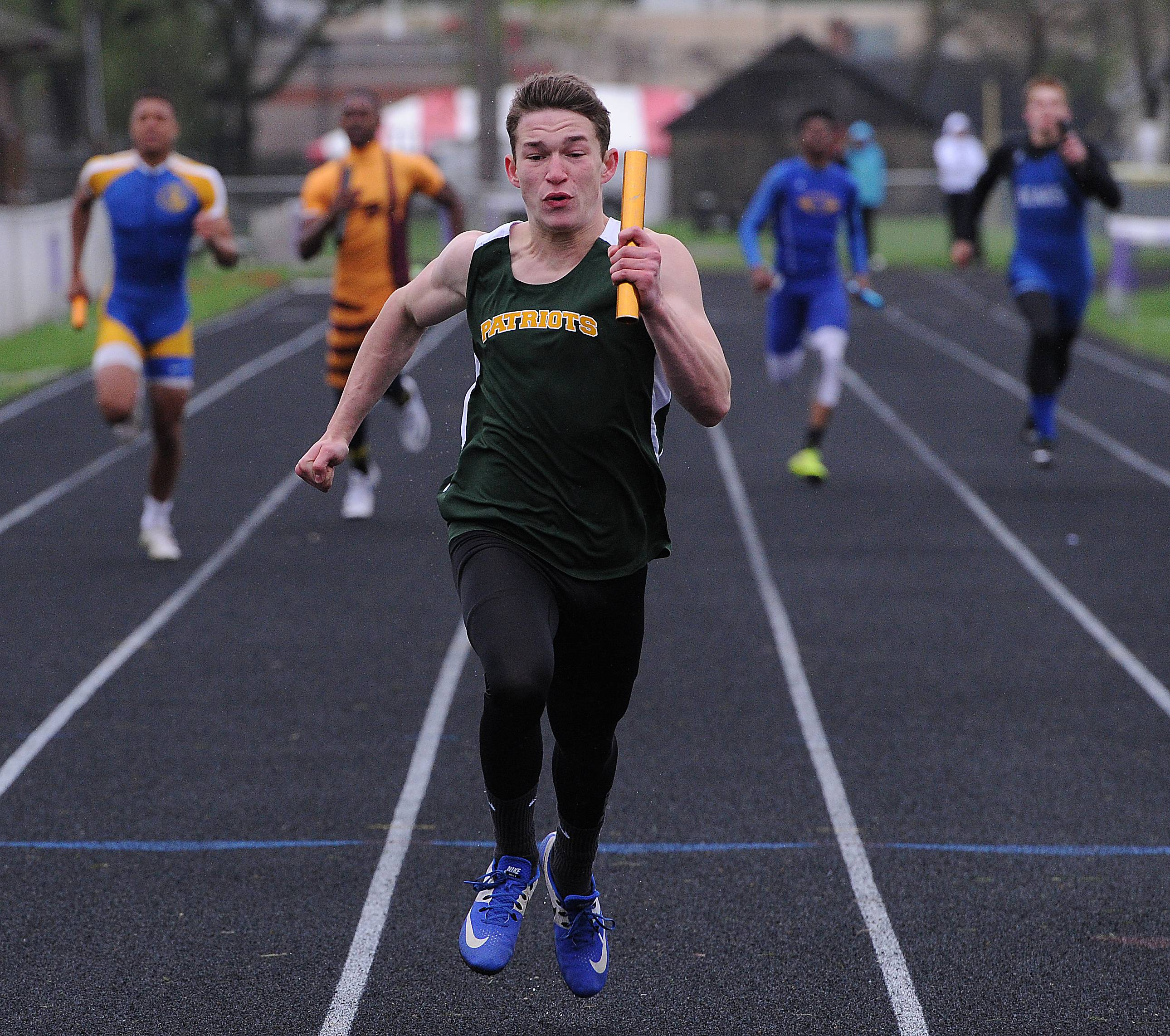 Stevenson's David Smolensky leads the pack with the anchor leg of the 4x200 relay at the NSC championships in Waukegan. The Patriots won the event, and the meet.