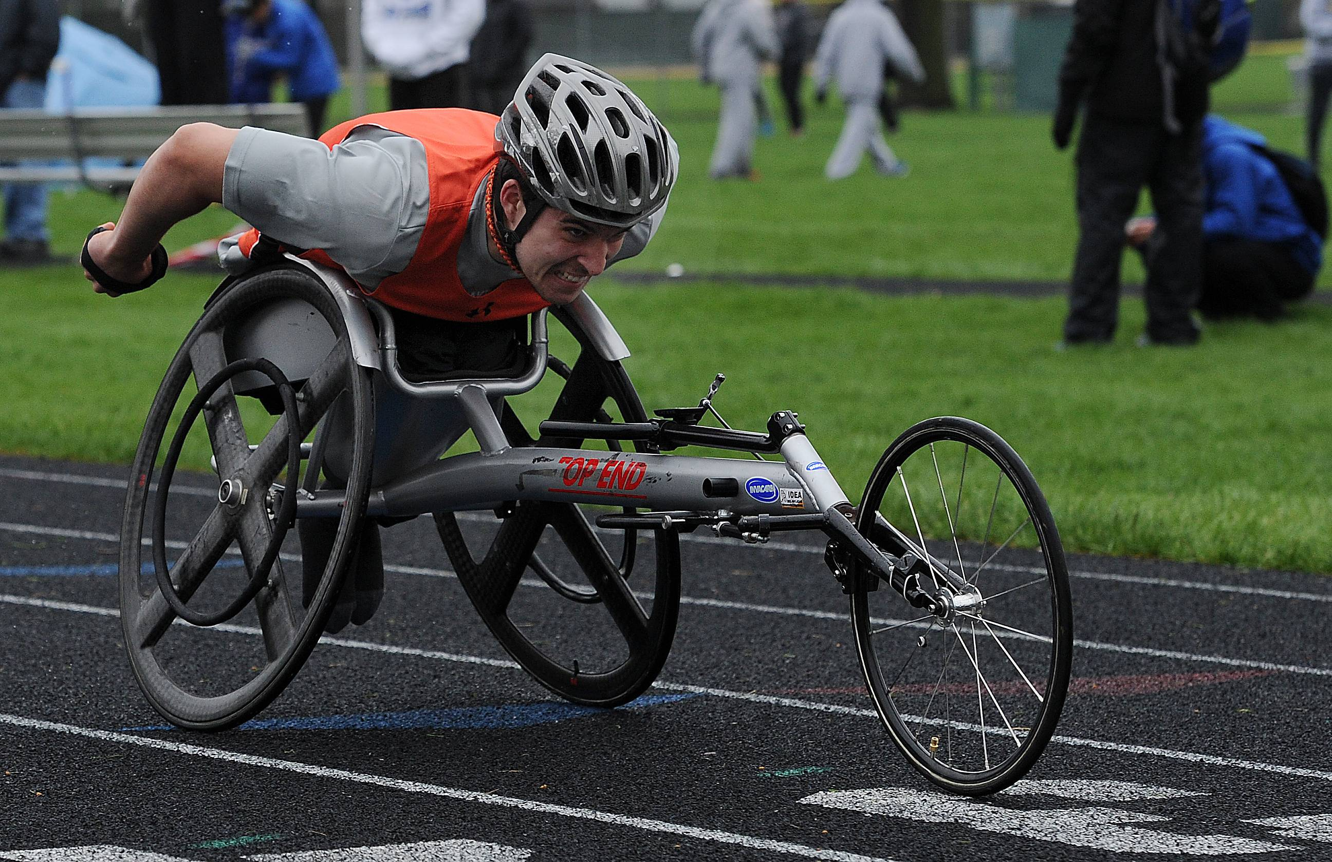 Libertyville's Ethan Burkhart powers ahead in the 100-meter wheelchair race at the NSC championships in Waukegan.