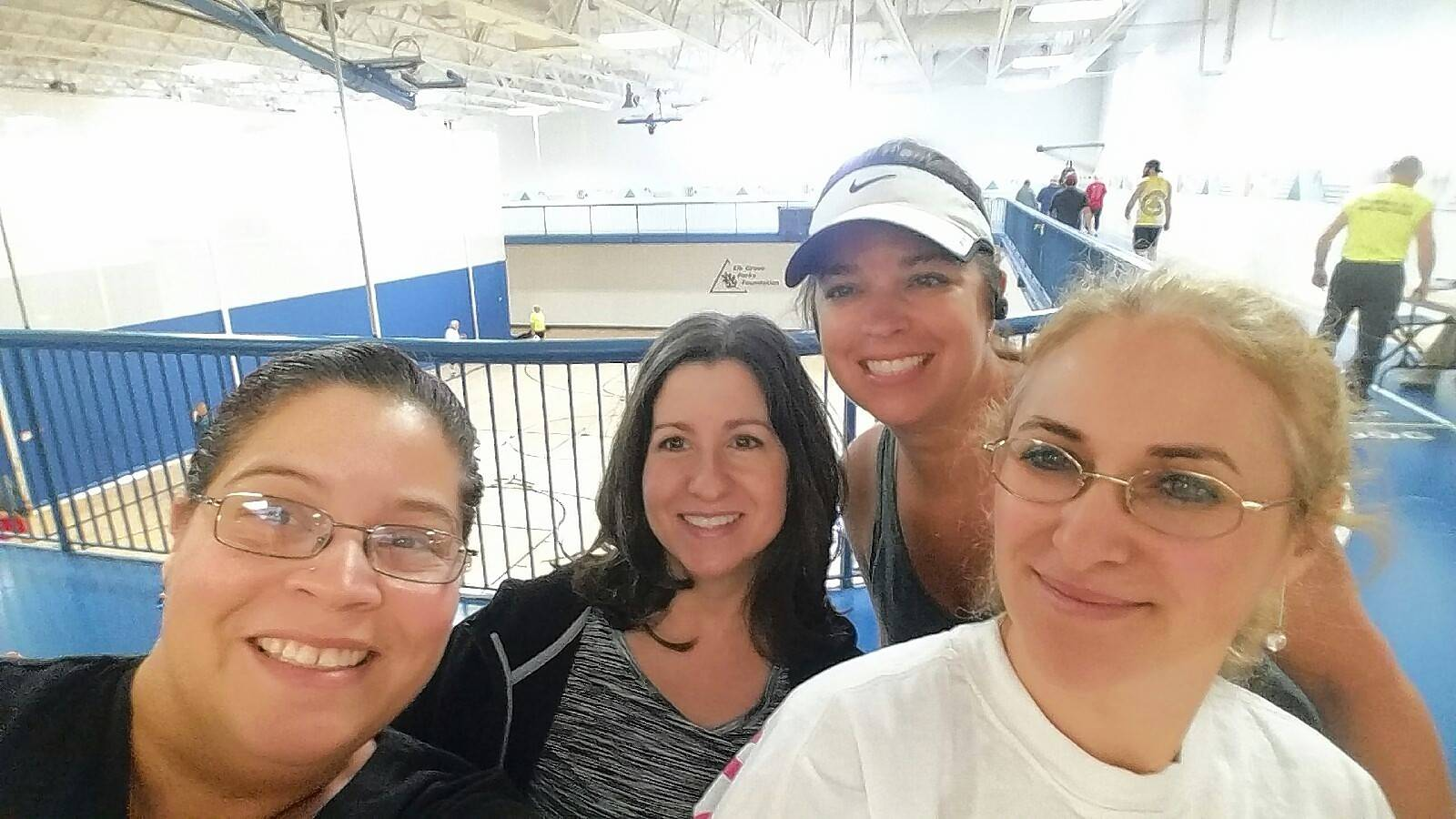 Team WOW from Wings Program, Inc. has fun at the Indoor 5K. From left to right: Deyanira Suarez, Judy Flint, Denise Urban, and Bruna Srb.