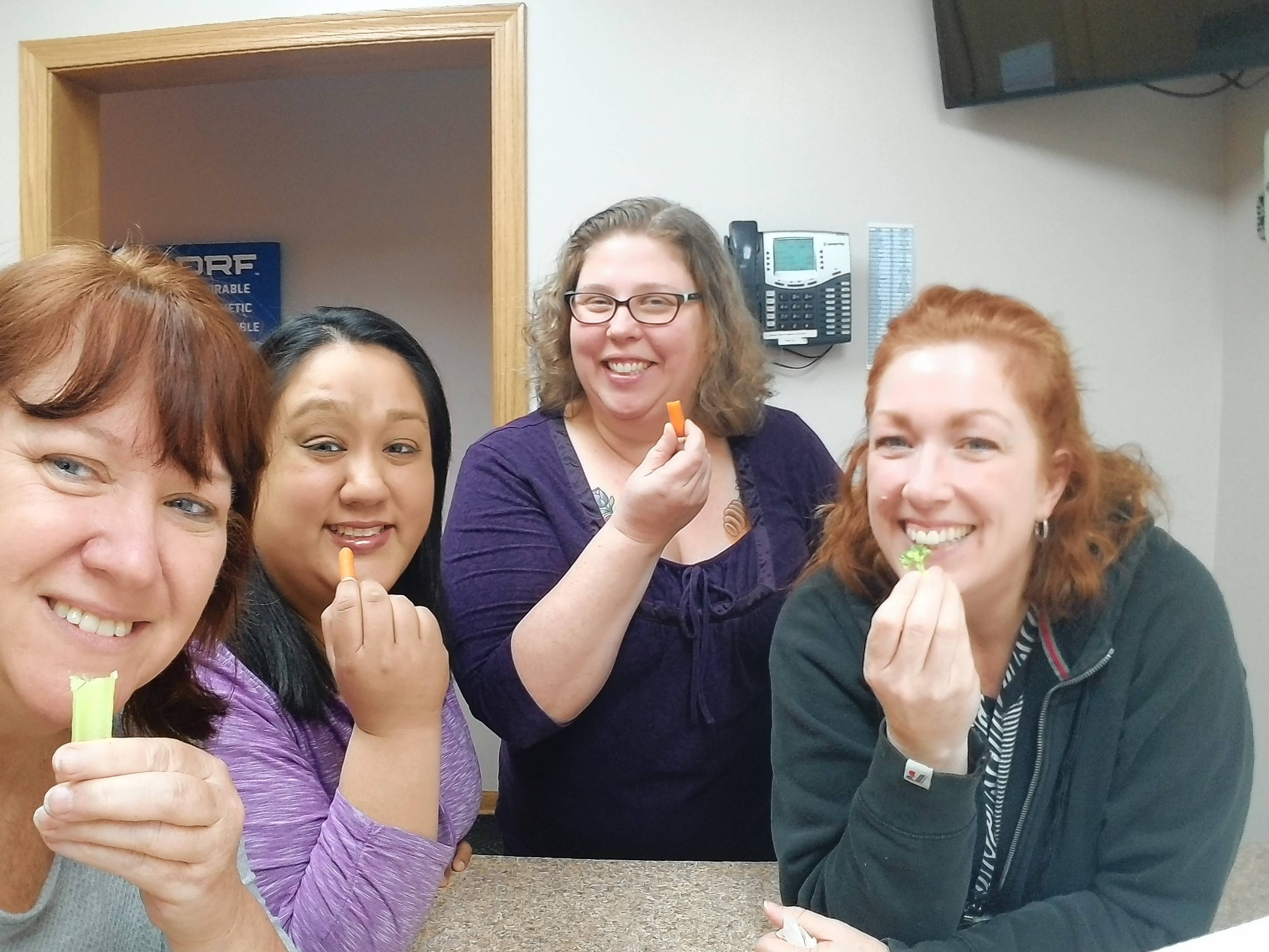 DRF Property Solutions' Healthy Heroes avoided sweets and enjoys some tasty veggies. From left to right: Joyce Gillette, Carolyna Castaneda, Ellen Ramirez, and Kelli Aiardo.