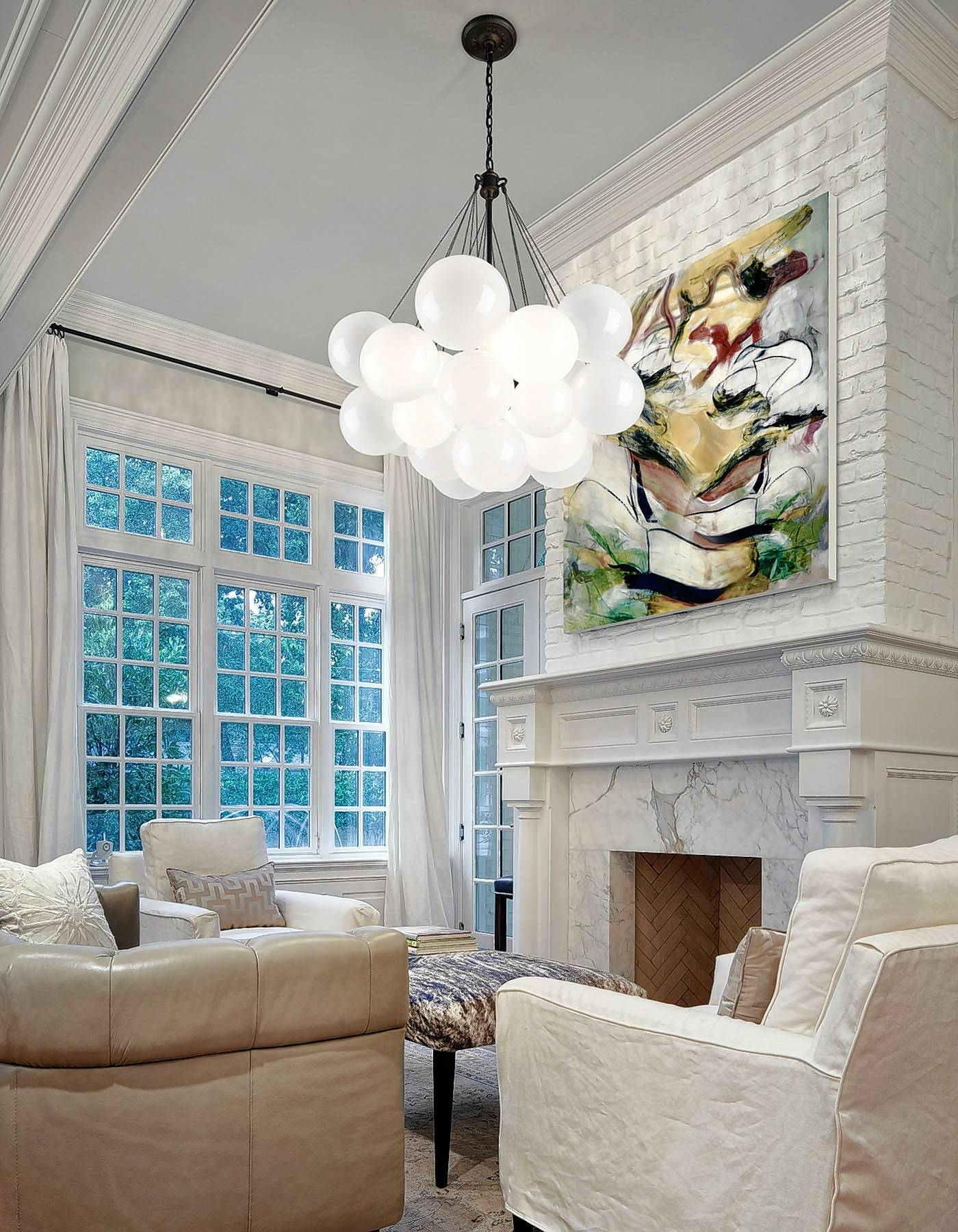 Notice the large art over the fireplace and how it forces the eye up toward the thick crown molding above the fireplace.