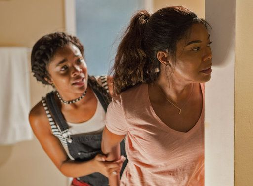 "This image released by Universal Pictures shows Ajiona Alexus, left and Gabrielle Union in ""Breaking In."" (Paul Sarkis/Universal Pictures via AP)"