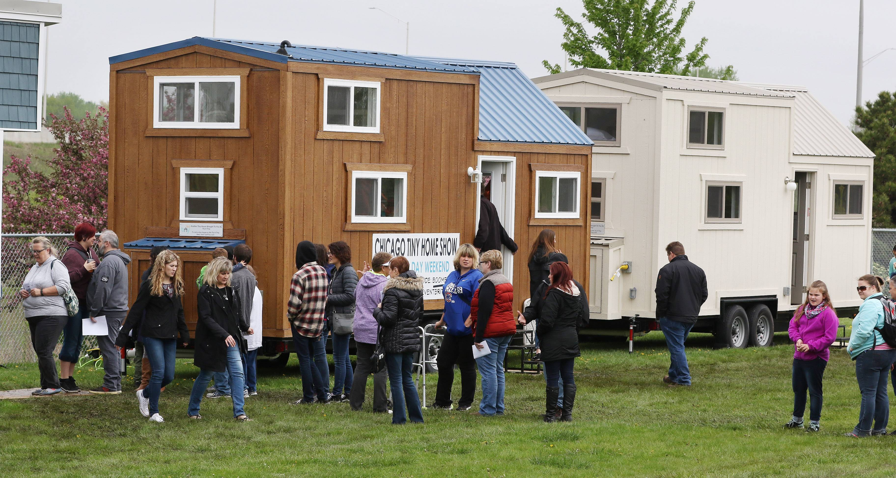 Visitors to the 2018 Chicago Tiny House Show line up Sunday to get inside some of the seven tiny home models on display at Boomers Stadium in Schaumburg.