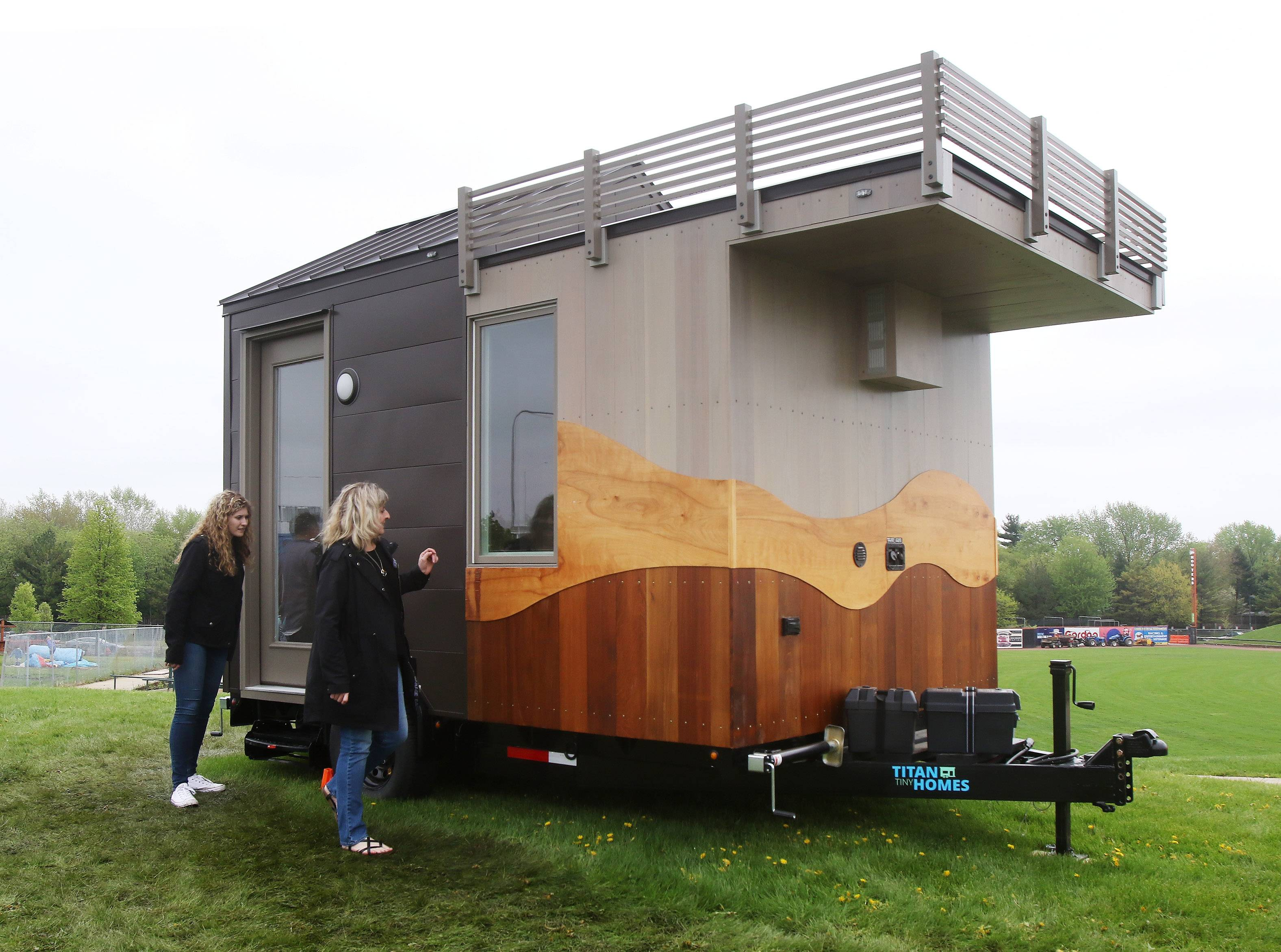 Susan Bolt of Gilberts, right, and her daughter, Bridget, 18, look at a smaller model home by Titan Tiny Homes during the 2018 Chicago Tiny House Show on Sunday at Boomers Stadium in Schaumburg.