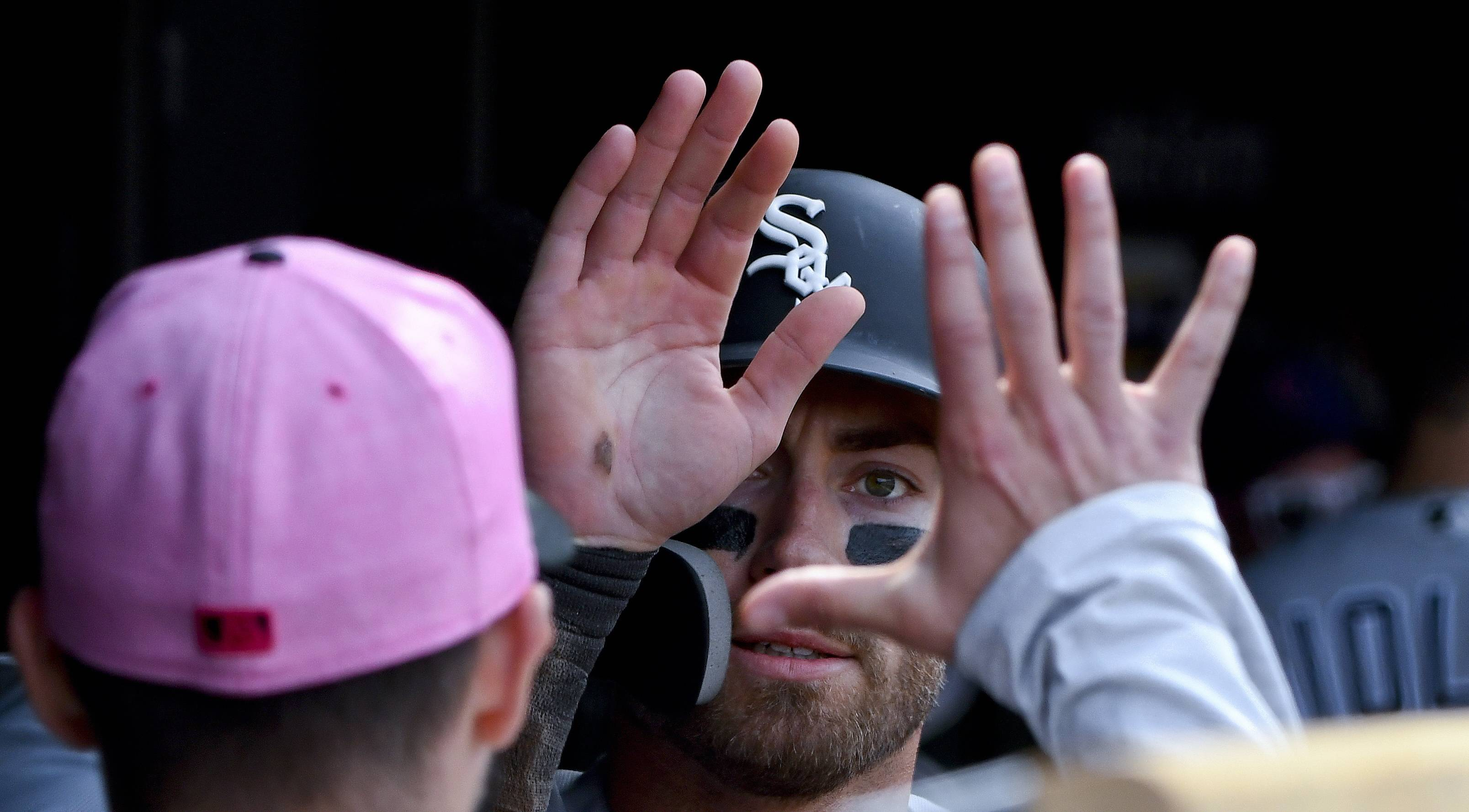 Chicago White Sox's Nicky Delmonico, center, celebrates in the dugout after he scored during the sixth inning of a baseball game against the Chicago Cubs on Sunday, May 13, 2018, in Chicago.