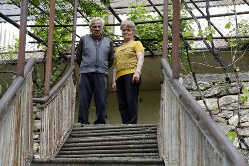 "In this photo taken on Sunday, May 6, 2018, Vova PashinIan, right, father of the Armenian protest leader Nikol Pashinian, and Erdzhanuhi, his stepmother, stand outside their house, in Idjevan town, northern Armenia. Hope has bloomed in the hometown of Armenia's newly-named prime minister, for people see him as a man who was able to articulate their anger and will now focus on their needs. Nikol Pashinian, who spearheaded weeks of anti-government protests, was named the country's new leader on May 8. Like the rest of the country, his hometown Idjevan, a city of 20,000 that sits on a key highway linking Armenia with Georgia, has been plagued by unemployment and grinding poverty after a plant processing bentonite clay and other factories closed years ago. His father recalled that his son once told him: ""If I don't fight, how will our people live? In poverty? Unemployment?�"