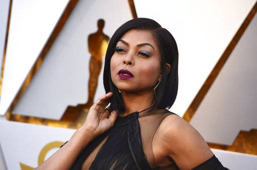 "FILE - In this March 4, 2018, file photo, Taraji P. Henson arrives at the Oscars at the Dolby Theatre in Los Angeles. Henson got more than a card on Mother's Day. The ""Empire� actress got engaged to former Super Bowl star Kelvin Hayden. (Photo by Jordan Strauss/Invision/AP, File)"