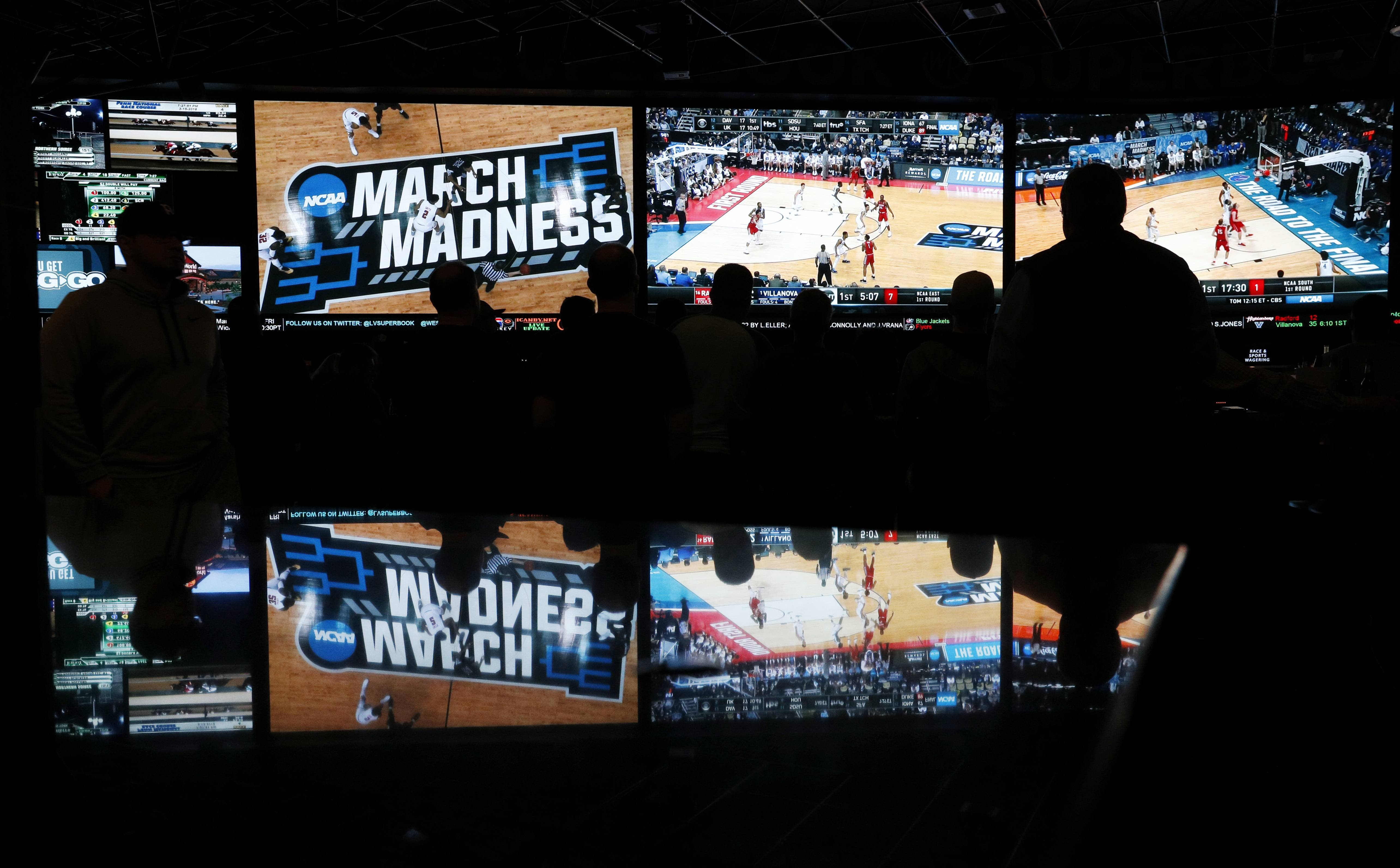 Fans were keenly interested in the first round of the NCAA college basketball tournament at the Westgate Superbook sports book in Las Vegas in March. The Supreme Court has struck down a federal law that bars gambling on football, basketball, baseball and other sports in most states, giving them the go-ahead to legalize betting on sports.