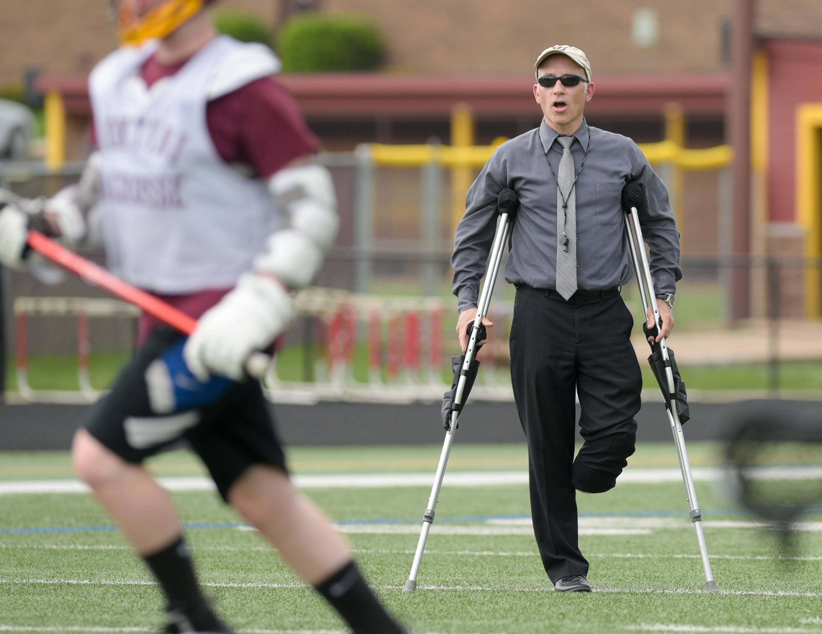 Michael Thuma, Montini boys lacrosse coach, who recently lost a leg to cancer but continues to coach.