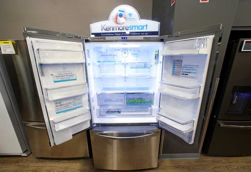 FILE - In this July 20, 2017, file photo, the Kenmore Elite Smart French Door Refrigerator appears on display at a Sears store in West Jordan, Utah. In a move announced Monday, May 14, Sears Holdings Corp. says a special committee of its board is starting a formal process to explore the sale of its Kenmore brand and related assets.