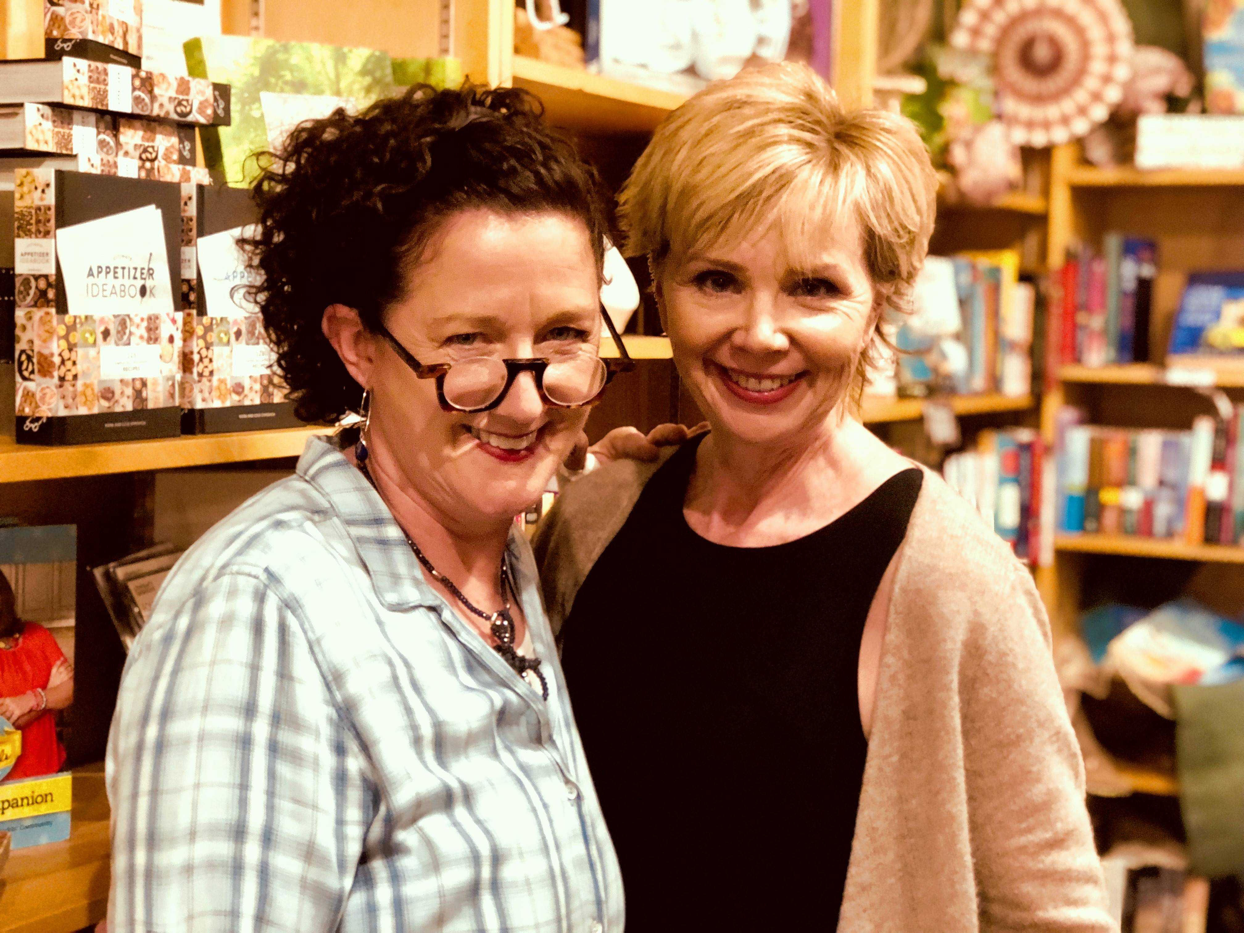 Owners Sandy Koropp, left, and Jenny Riddle inside Wheaton's Prairie Path Books. The pair plan to open a second store in the city's downtown.