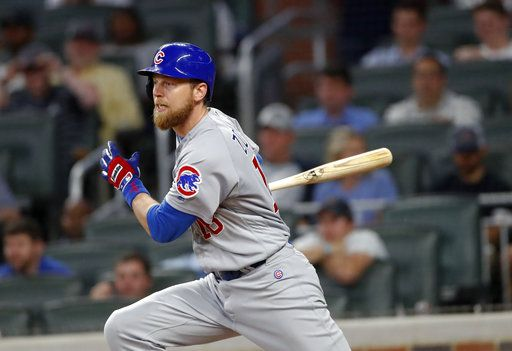 Chicago Cubs' Ben Zobrist watches his base hit that drove in the go-ahead run in the ninth inning of a baseball game against the Atlanta Braves on Tuesday, May 15, 2018, in Atlanta. Chicago won 3-2.