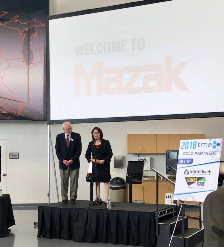 Lt. Governor Evelyn Sanguinetti speaks to the crowd at the 2018 Precision Machining Competition, along with Technology & Manufacturing Association President Steven Rauschenberger.
