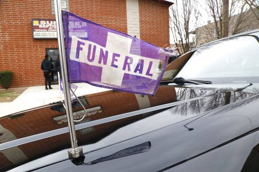 A funeral flag waves on a hearse outside a church on Chicago's West Side on Friday, April 13, 2018, during the service for 16-year-old Jaheim Wilson, who was shot and killed a few days earlier. Wilson was a cousin of Alexis Willis, who is a Peace Warrior at North Lawndale College Prep High School.