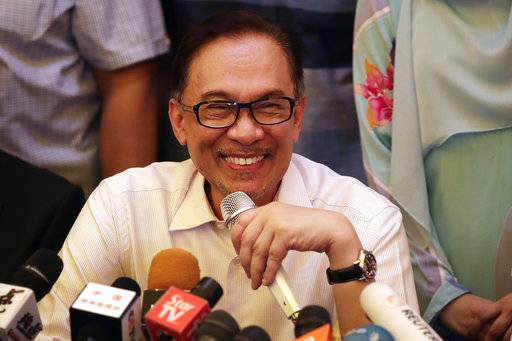 Malaysia's reformist icon Anwar Ibrahim smiles during a press conference at his residence in Kuala Lumpur, Malaysia, May 16, 2018. Anwar has been freed from custody after receiving a pardon from the king, paving the way for a political comeback following his alliance's stunning election victory.
