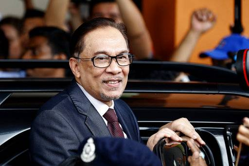 Malaysia jailed opposition icon Anwar Ibrahim leaves a hospital in Kuala Lumpur, Malaysia, Wednesday, May 16, 2018. Prime Minister Mahathir Mohamad said Malaysia's king had agreed to pardon Anwar, who was jailed in 2015 for sodomy in a conviction that he said was politically motivated.