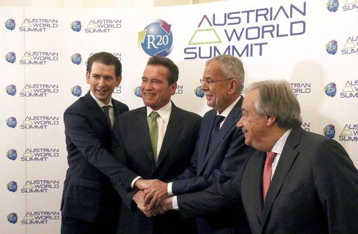 Austrian Chancellor Sebastian Kurz, former California Gov. Arnold Schwarzenegger, Austrian President Alexander Van der Bellen and United Nations Secretary General Antonio Guterres, from left, pose before the R20 Austrian world summit at the Hofburg palace Vienna, Austria, Tuesday, May 15, 2018.