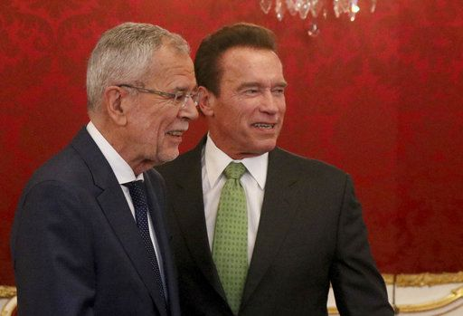 Austrian President Alexander Van der Bellen welcomes former California Gov. Arnold Schwarzenegger, right, before the R20 Austrian world summit at the Hofburg palace Vienna, Austria, Tuesday, May 15, 2018.