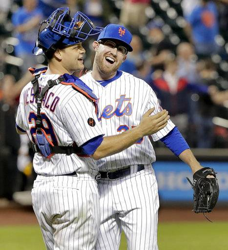 New York Mets catcher Devin Mesoraco (29) celebrates with pitcher Jacob Rhame after the Mets defeated the Toronto Blue Jays 12-2 in a baseball game Tuesday, May 15, 2018, in New York.