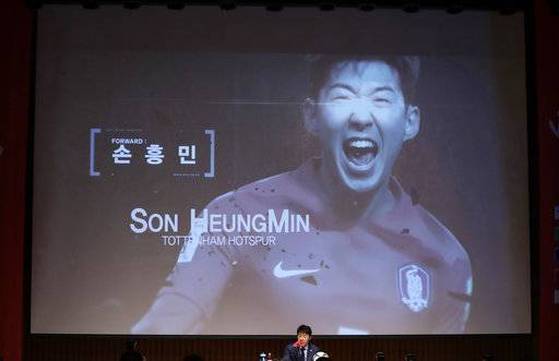South Korea's national soccer team head coach Shin Tae-yong, center bottom, announces a name of Son Heung-min as a member of squad for the 2018 Russia World Cup during a press conference in Seoul, South Korea, Monday, May 14, 2018.