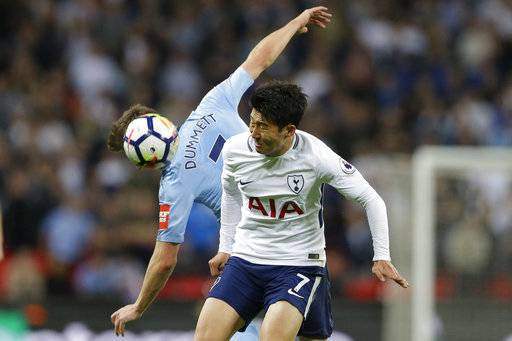 Newcastle United's Paul Dummett, rear, and Tottenham Hotspur's Son Heung-min vie for the ball during the English Premier League soccer match between Tottenham Hotspur and Newcastle United at Wembley Stadium, in London, England, Wednesday, May 9, 2018.