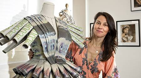 Work by College of DuPage student Zlatka Burtis is featured in an exhibit in the Wings Gallery. It fuses fashion and photography by showcasing dresses created from newspapers.