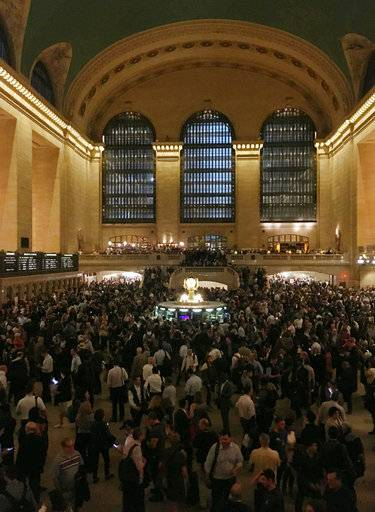 Commuters are stranded during the evening commute at Grand Central Terminal in New York on Tuesday, May 15, 2018. The Metro-North commuter railroad said Tuesday evening that downed trees across the tracks had caused it to suspend service on its Harlem, Hudson and New Haven lines. Entrances to Grand Central Terminal were closed and passengers were being turned away to prevent the station from getting too crowded.