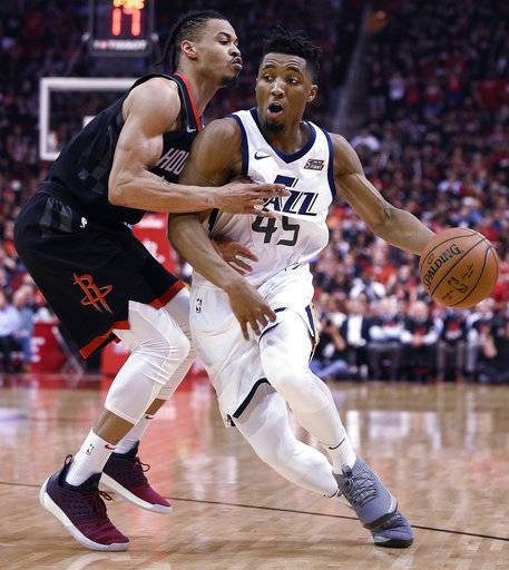 FILE - In this May 8, 2018, file photo, Utah Jazz guard Donovan Mitchell, right, dribbles as Houston Rockets guard Gerald Green defends during the second half in Game 5 of an NBA basketball second-round playoff series in Houston. Green's years as an underdog--along with his length and athleticism--could be just what Houston needs Wednesday night when the Rockets try to even up the Western Conference finals after losing Game 1 of the series to the Golden State Warriors.
