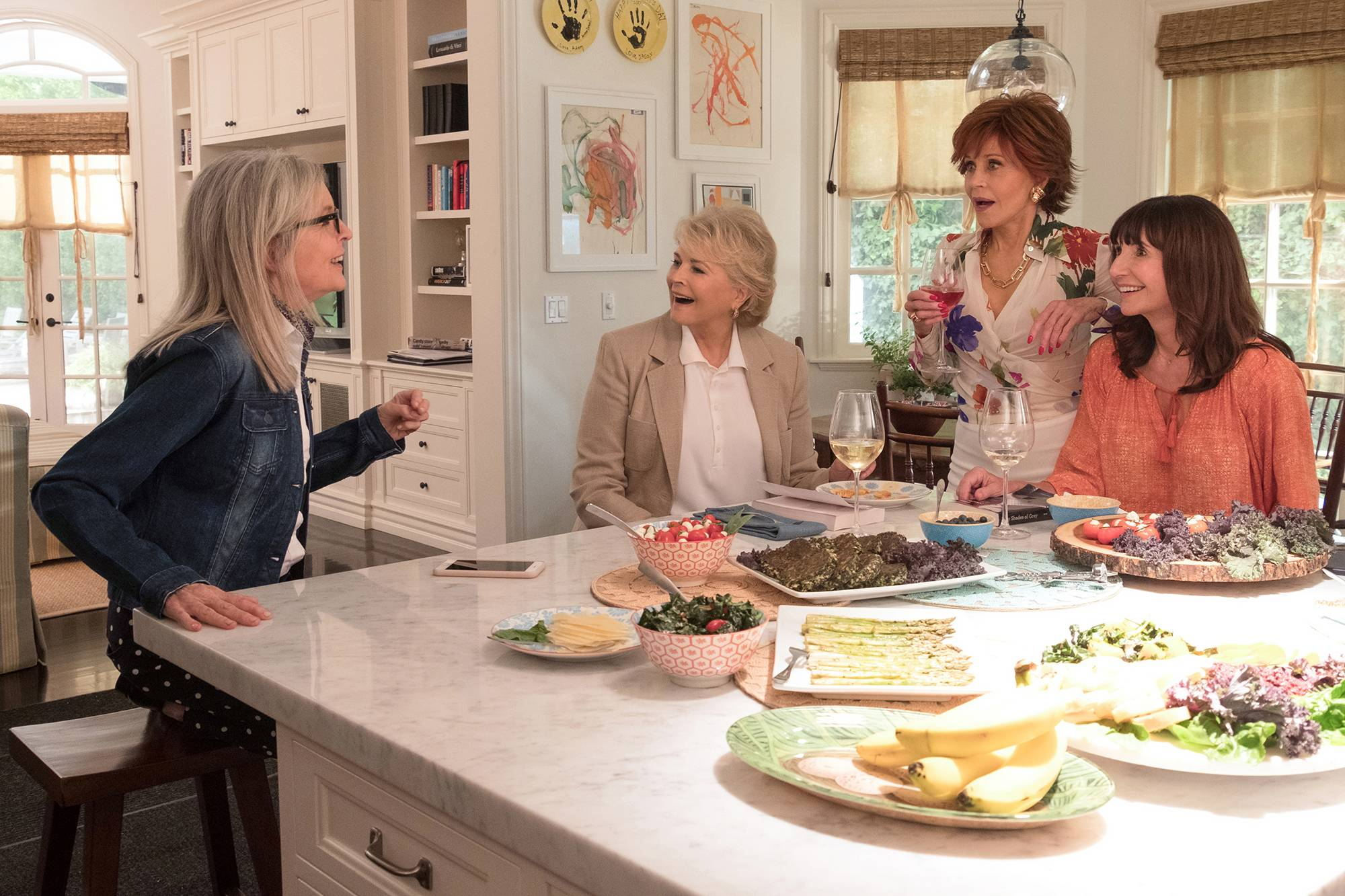 "Four friends -- played by Diane Keaton, left, Candice Bergen, Jane Fonda and Mary Steenburgen -- wash down reading selections with plenty of wine in ""Book Club."""