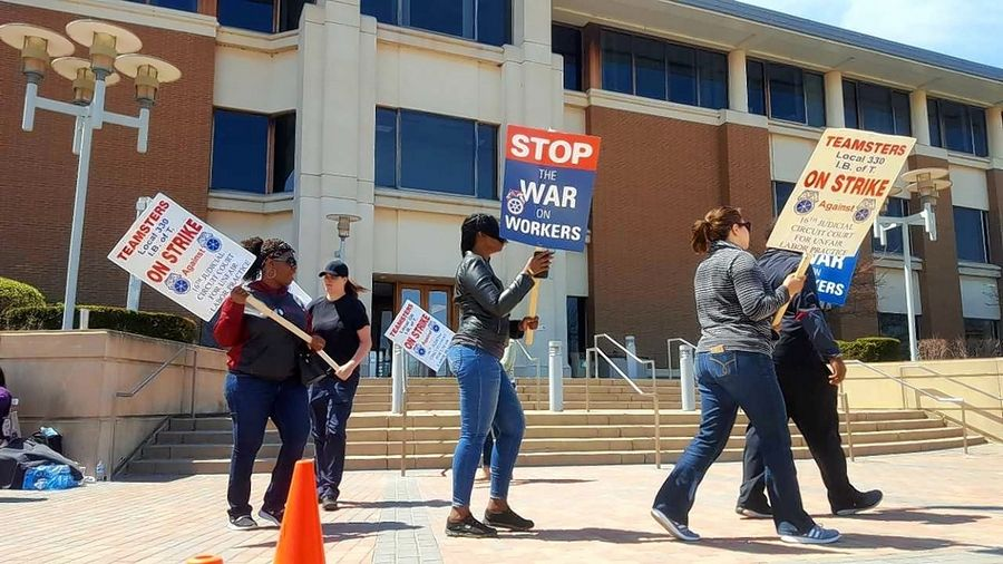 Court services workers picket in front of the Kane County Judicial Center April 30.