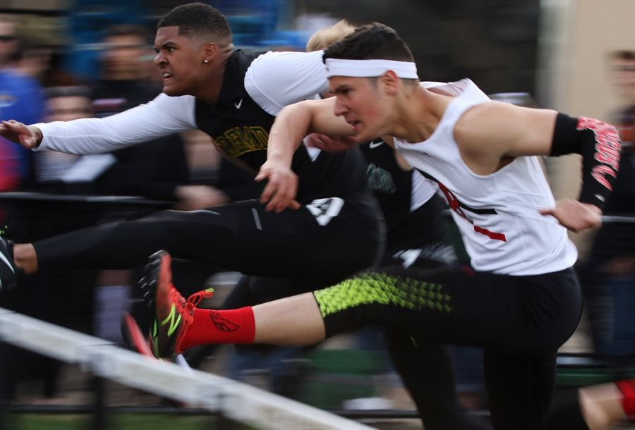 Fremd's Jaden Jackson, left, is even with Barrington's Kevin Curet in the 110-meter hurdles during the Class 3A Grayslake North boys track sectional Thursday.