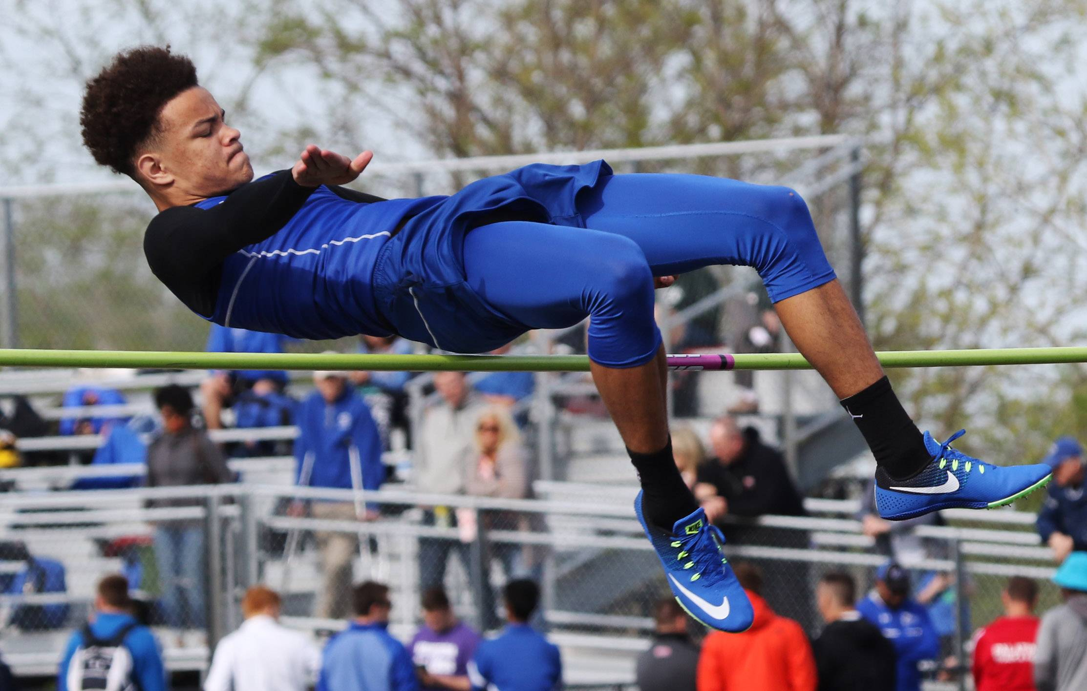 Warren high jumper Branden Ellis clears the bar at 6 feet, 3 inches during the Class 3A Grayslake North boys track sectional Thursday.
