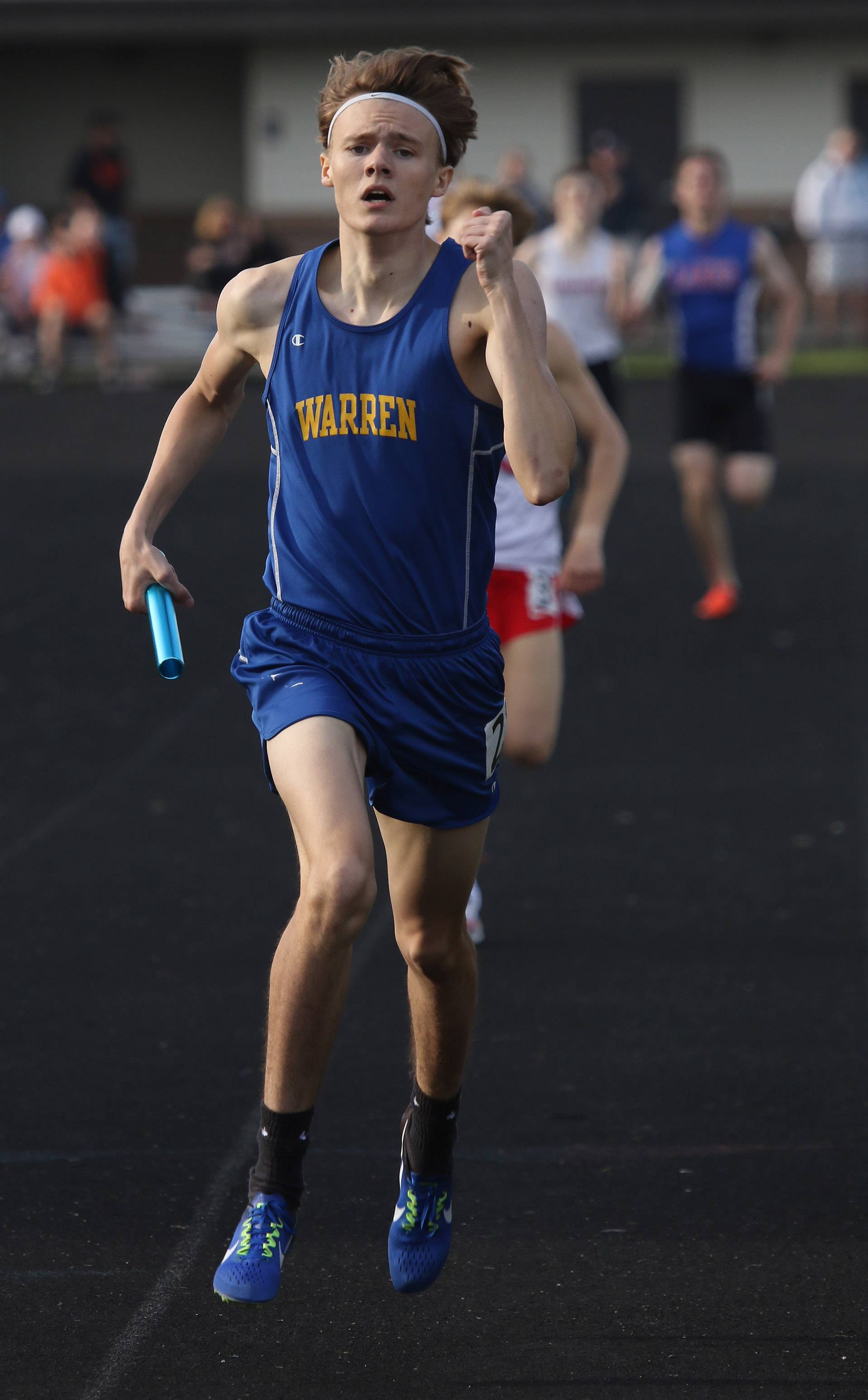 Warren runner Brian Holland finishes the 4x800m relay during the Class 3A Grayslake North boys track sectional.