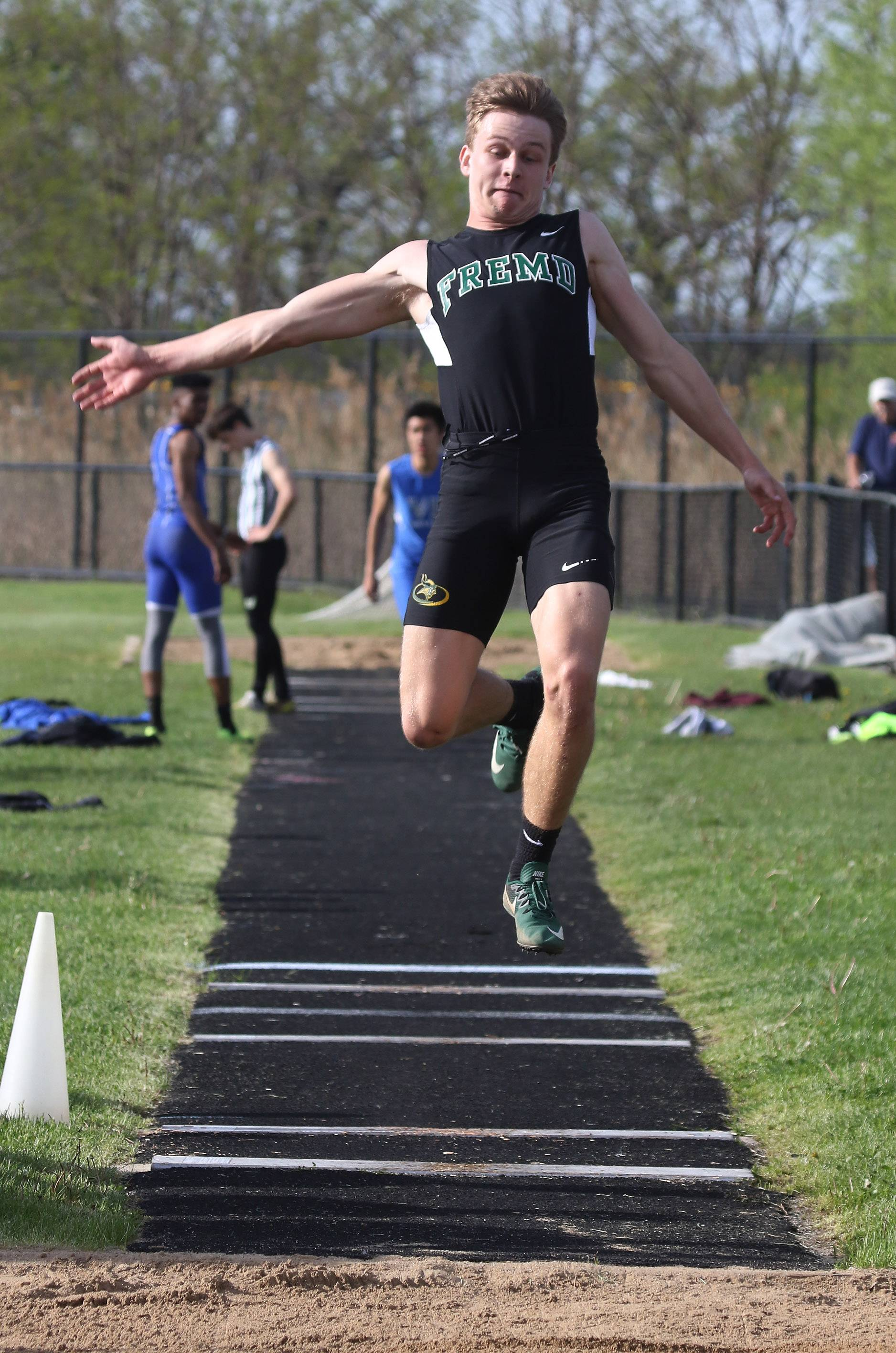 Fremd long jumper Brian Chindblom wins the event during the Class 3A Grayslake North boys track sectional Thursday.