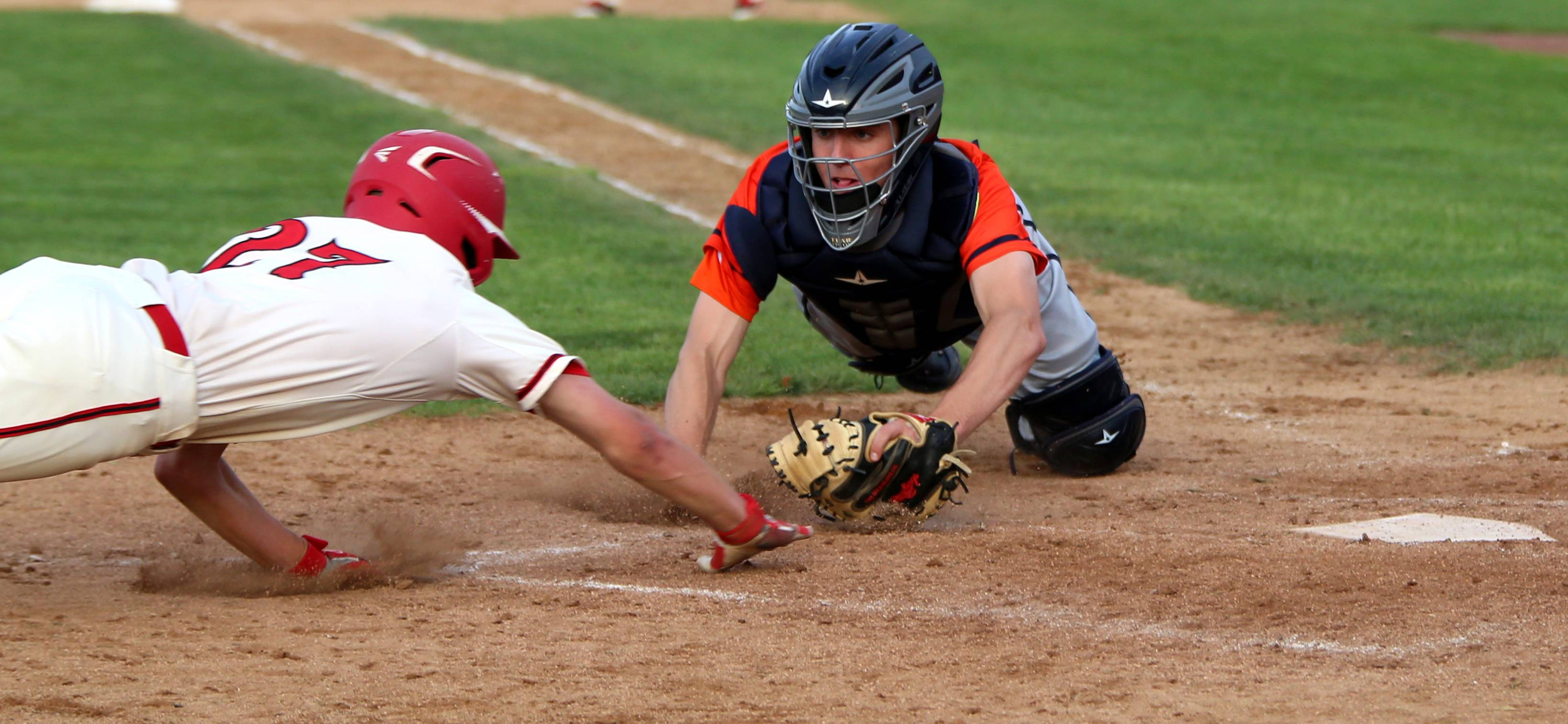 Buffalo Grove catcher Carter Gledhill prepares to tag Barrington's Nick Bogaerts at home plate during the Mid-Suburban League title game action at Coach Kirby Smith Field in Barrington on Thursday. Bogaerts was out on the play.