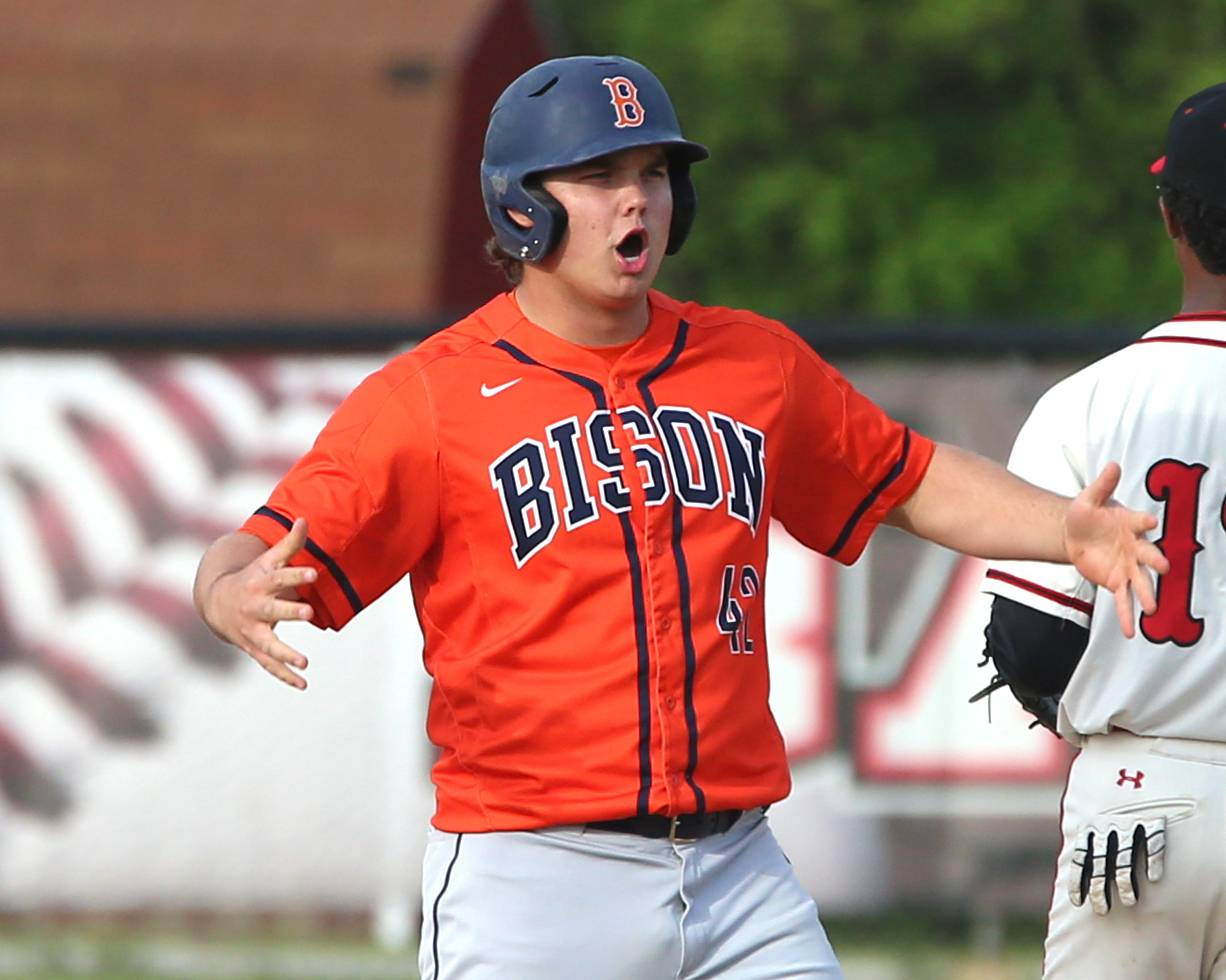 Buffalo Grove's Riley Rundquist celebrates his arrival at second base with a double against Barrington during the Mid-Suburban League title game at Coach Kirby Smith Field in Barrington on Thursday.