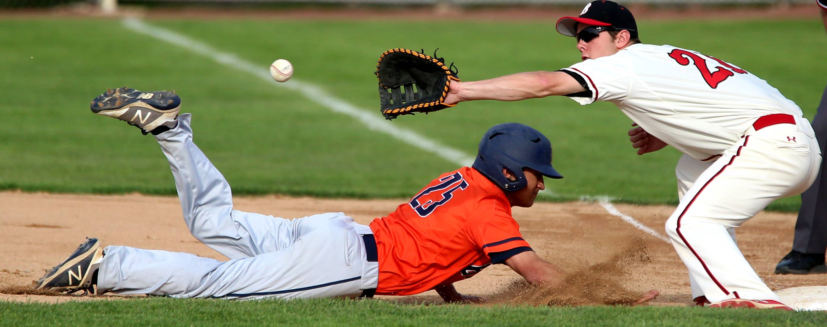 Buffalo Grove's Alex Paul gets safely back to first base as Barrington's David Mitchell fields the pickoff throw during the Mid-Suburban League title game at Coach Kirby Smith Field in Barrington on Thursday.