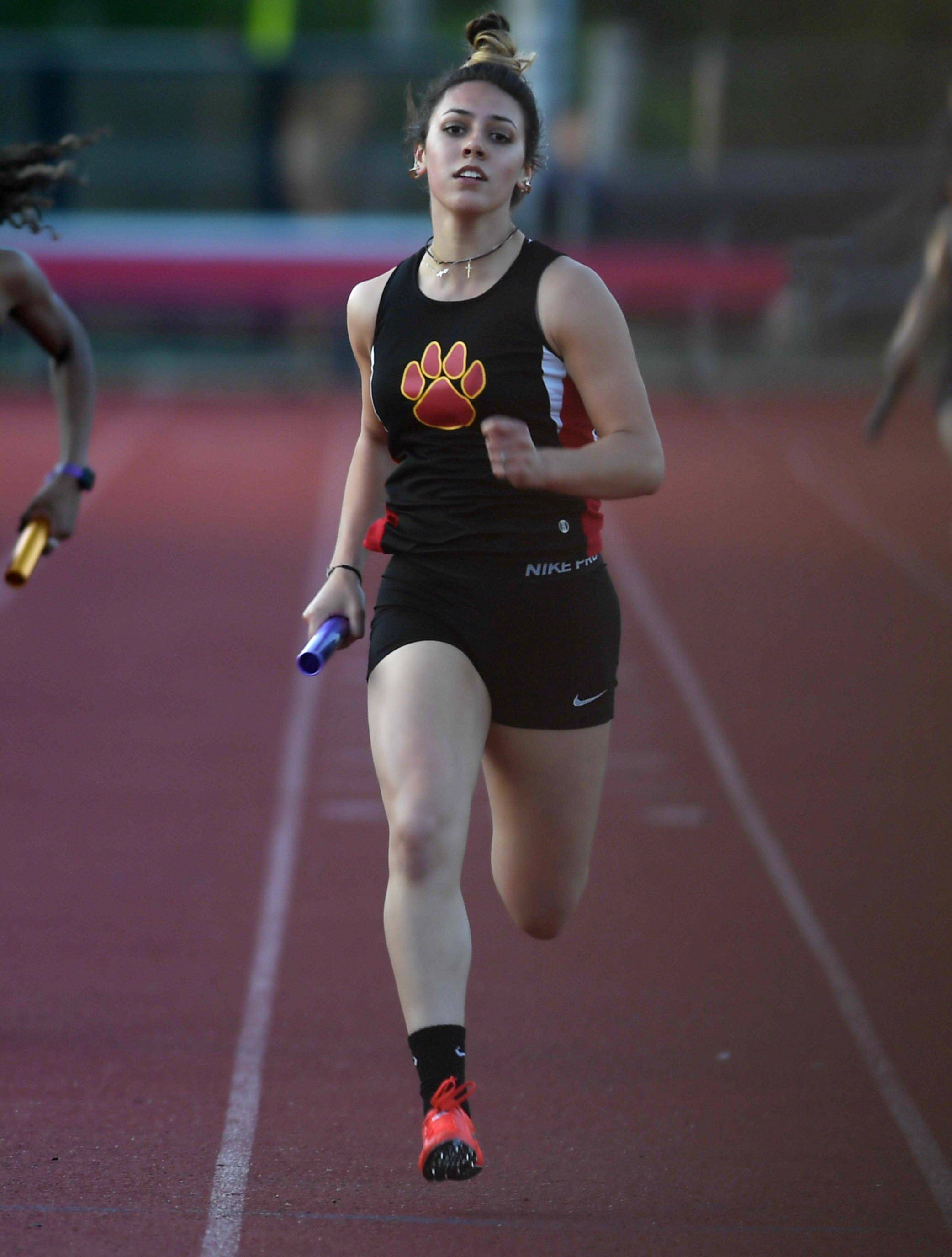 Batavia's Tori Ortiz finishes the 800 meter relay at the West Aurora girls sectional track meet last week.
