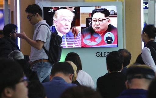 People watch a TV screen showing file footage of U.S. President Donald Trump, left, and North Korean leader Kim Jong Un during a news program at the Seoul Railway Station in Seoul, South Korea, Friday, May 18, 2018. North Korea strongly criticized South Korea over ongoing U.S.-South Korean military exercises on Thursday and said it will not return to talks with its rival until Seoul resolves its grievances.